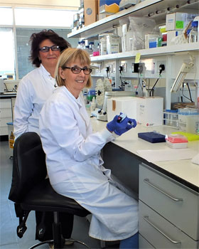 Dr Cinzia Scarpini (standing) and Mrs Dawn Ward (sitting) in Prof N. Coleman's and Dr Matthew Murray's laboratory